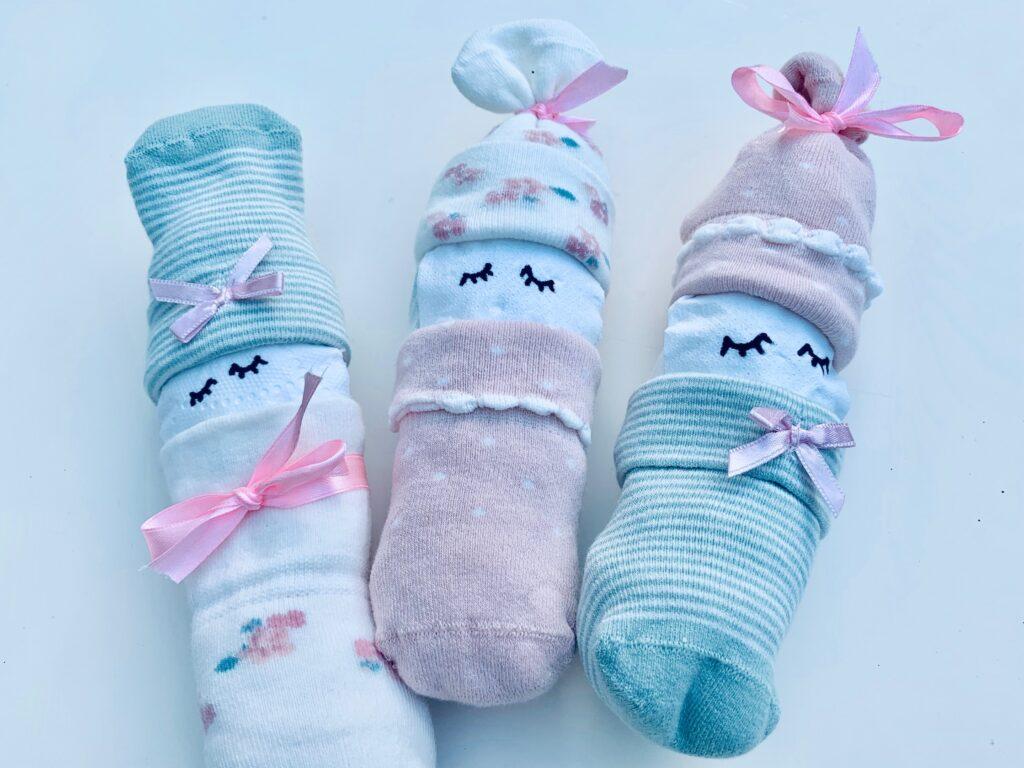 Geburtsgeschenk drei schlafende Strampler Männchen